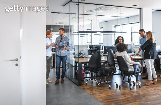 Two Small Business Group Discussions in Open Plan Office - gettyimageskorea