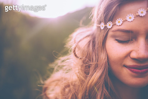Face of a boho girl with a vintage flowered headband - gettyimageskorea