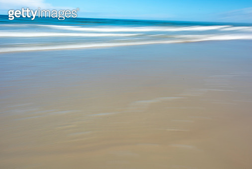 View of Beach against a blue sky with motion - gettyimageskorea