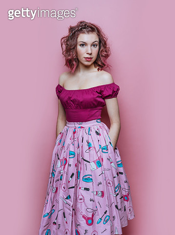 Young woman with pink dress on pink background - gettyimageskorea