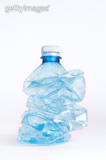 Crumpled empty blue plastic bottle isolated on white background - gettyimageskorea