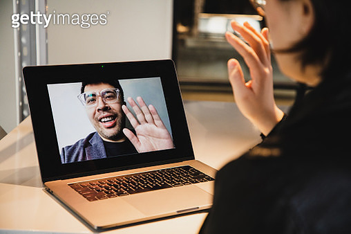 asian woman video conference with asian man - gettyimageskorea