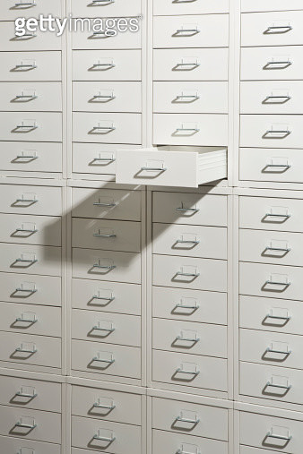 A white cabinet of drawers with one drawer open - gettyimageskorea