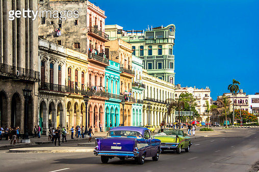 View of downtown Havana city with old classic cars and people walking on the street, Cuba. - gettyimageskorea