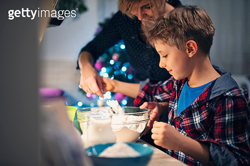Mother and son preparing Christmas cookies - gettyimageskorea