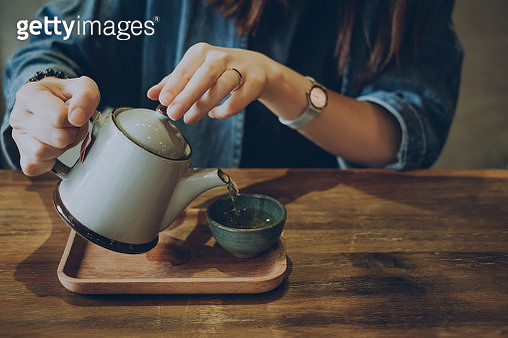 Woman enjoying a quiet time with a fresh cup of tea - gettyimageskorea