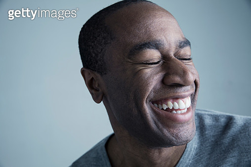 Portrait African American man smiling with eyes closed - gettyimageskorea