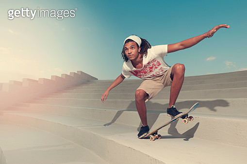 African American man riding skateboard at staircase - gettyimageskorea