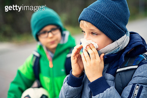 Sick boy going to school and cleaning nose - gettyimageskorea