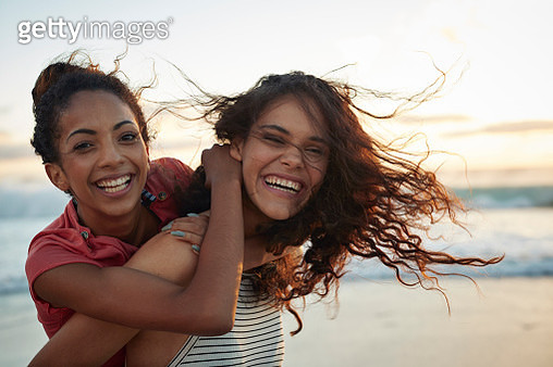 Young women hanging out at the beach, at sunset - gettyimageskorea