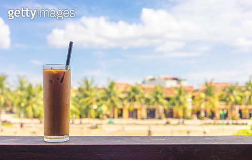 defocused images of an iced coffee with Hoi An city in background during day - gettyimageskorea