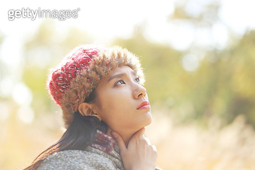 Young woman suffering from neck pain - gettyimageskorea