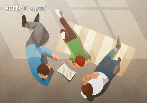 Family relaxing, reading book - gettyimageskorea