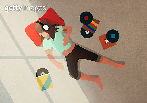 Carefree girl with headphones listening to records - gettyimageskorea