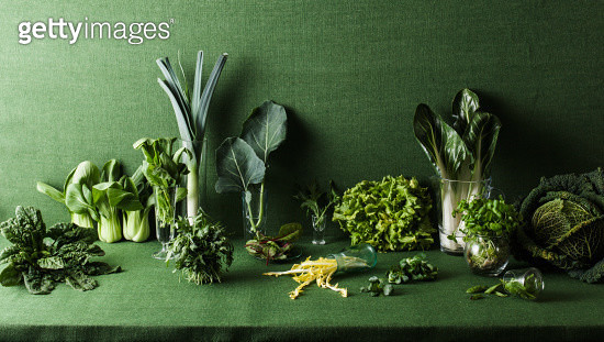 Assorted green vegetables on green table - gettyimageskorea