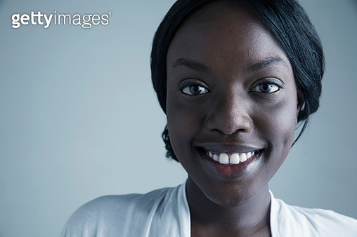Close up portrait smiling African American young woman - gettyimageskorea