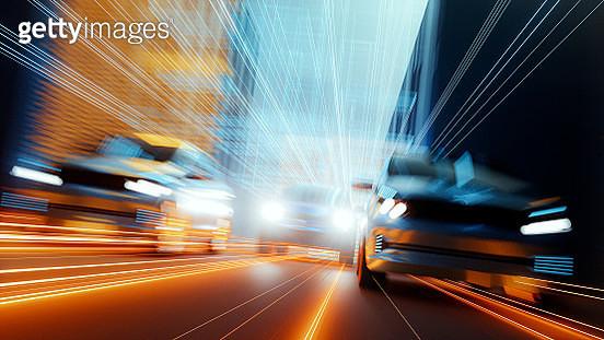Generic speeding cars in futuristic city - gettyimageskorea