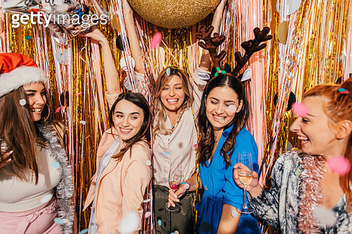 Smiling group of friends drinking champagne on New Year's Eve celebration party - gettyimageskorea