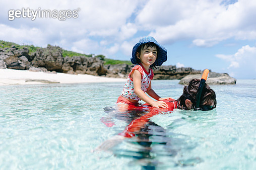Little girl having fun with mother in tropical water, Amami Islands, Japan - gettyimageskorea