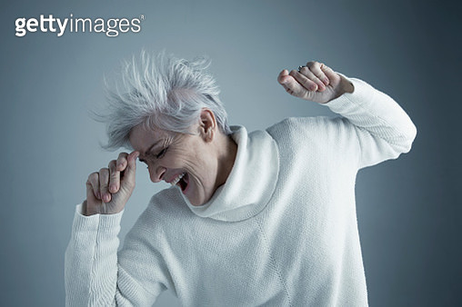 Portrait playful Caucasian senior woman with short gray hair dancing - gettyimageskorea