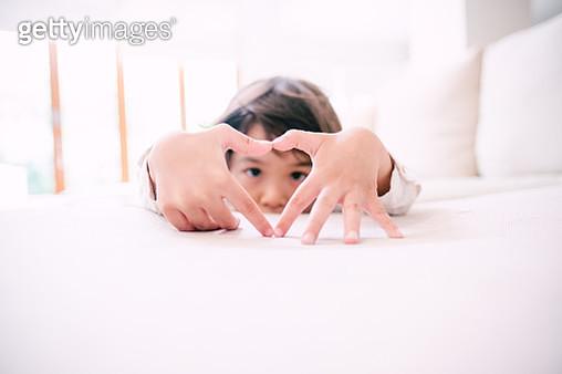 Lovely Little Kid Doing Love Sign - gettyimageskorea