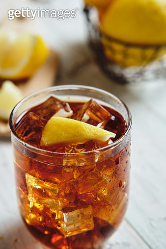 very cold cola on a white background with ice and lemon - gettyimageskorea