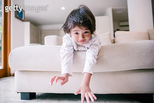 Playful Little Kid on Couch During Hari Raya Aidilfitri - gettyimageskorea