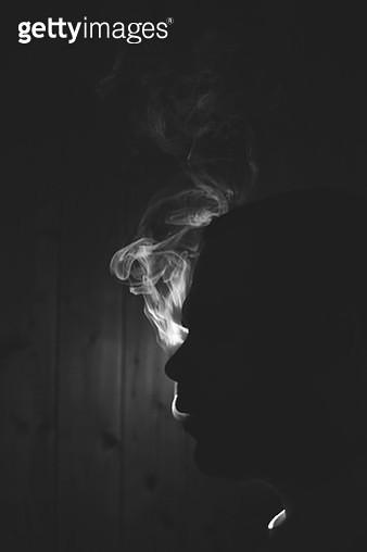 Man in smoke - gettyimageskorea