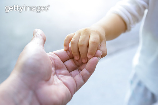 holding baby hand - gettyimageskorea