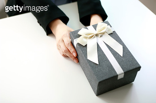 Close up of businesswoman holding gift box - gettyimageskorea