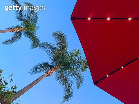Red beach umbrella with solar lights - gettyimageskorea