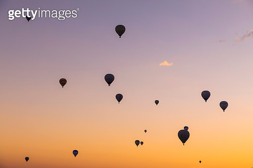 Hot air balloons at sunrise over the beautiful landscape in Cappadocia, Turkey - gettyimageskorea