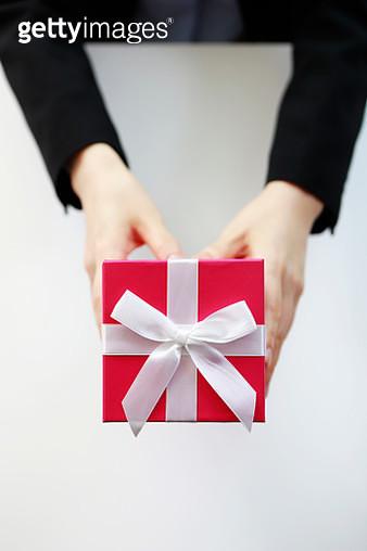Businesswoman holding gift box - gettyimageskorea
