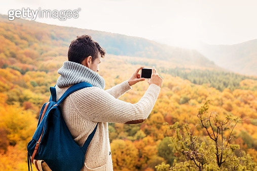 Handsome young man in autumn nature - gettyimageskorea