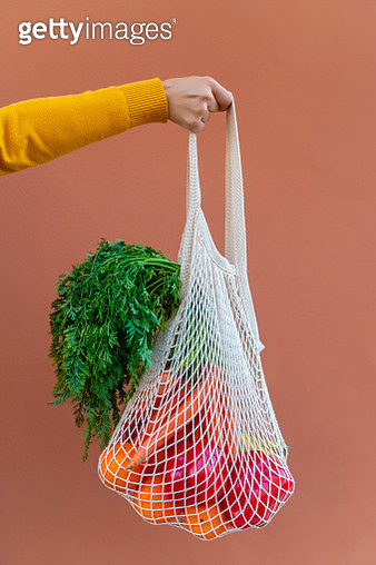 Woman Holding Reusable Cotton Mesh Bag With Fruit And Vegetables - gettyimageskorea