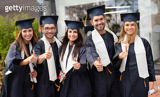 Happy group of graduate students with thumbs up - gettyimageskorea