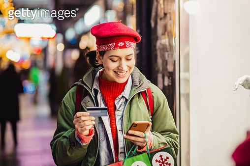 Young woman in a Christmas shopping using credit card - gettyimageskorea