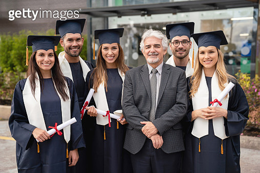 Happy teacher with a group of graduate students - gettyimageskorea