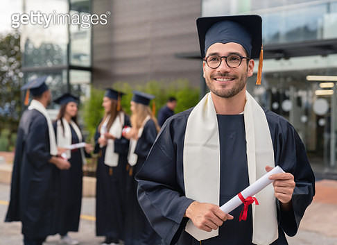 Male student looking happy on graduation day - gettyimageskorea