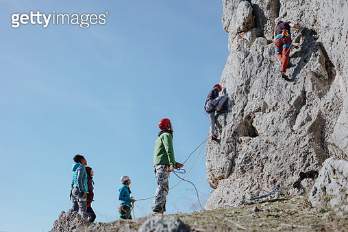 Two man climbs a rock with rope. Sport climbing, lead. - gettyimageskorea