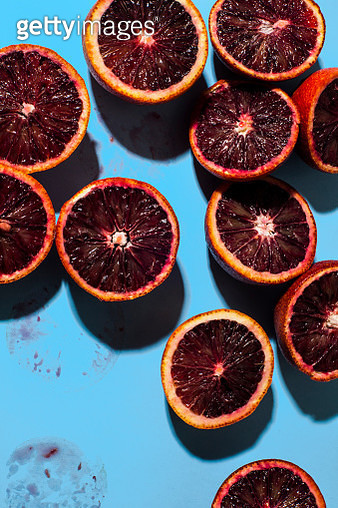 Blood Oranges on blue background - gettyimageskorea