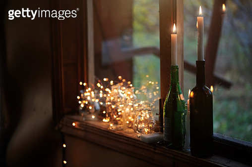 Log cabin decorated with Christmas light and candles - gettyimageskorea