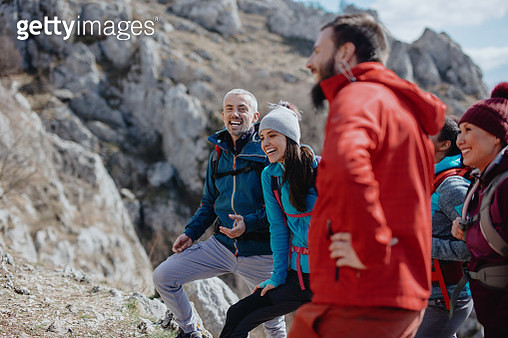 Climbing coach giving instruction about climbing safety - gettyimageskorea