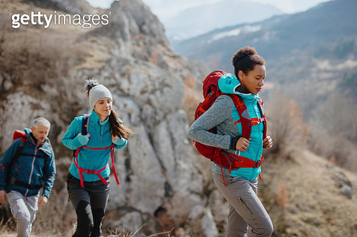 Group of mountaineers walking in the mountains - gettyimageskorea