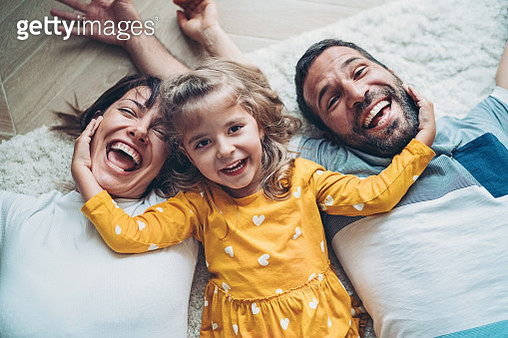 Fun portrait of two parents and a small girl - gettyimageskorea