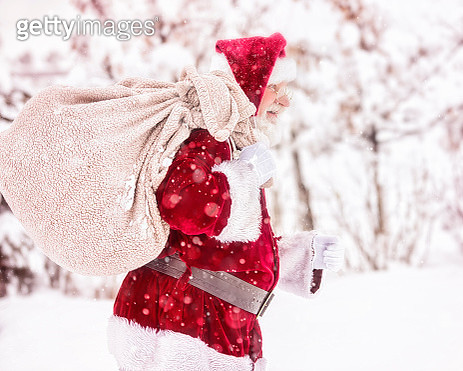 Santa Braving a Cold Winter Snow Storm To Carry Presents to Deserving Children - gettyimageskorea