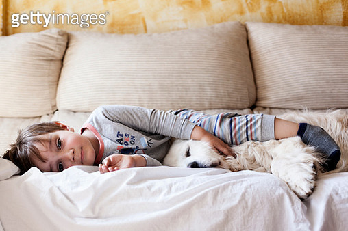 Child sleeping with his dog - gettyimageskorea