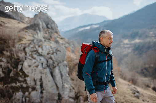Male hiker in the mountains with backpack - gettyimageskorea