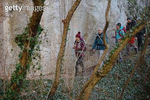 Hikers climbing the mountain - gettyimageskorea