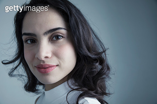 Close up portrait confident brunette Latina young woman - gettyimageskorea